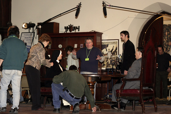 Stephen Payne directing production team and actors with Series Host Richard Payne seated on right and Associate Producter/First AD Jim Morlino in doorway.